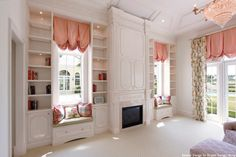 A Beautiful Built-In - So Bright & Airy - Not just one but two window seats with a fireplace surround and built in bookshelves - By Architectural Details & Woodworking, Inc
