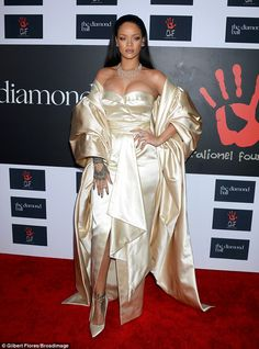 Going for gold: Rihanna was the belle of the ball wowing in a gold Dior gown and matching ...