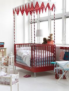 Beautiful red bed for wee ones.
