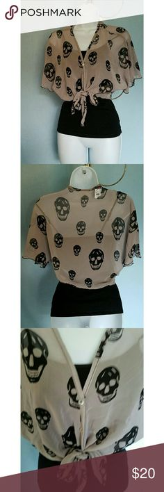 BODY CENTRAL SHEER CROP SKULL SHIRT BODY CENTRAL SHEER SKULL CROP SHIRT Great shirt that looks great with a camisole underneath. Can be tied at the waist. Body Central Tops Crop Tops