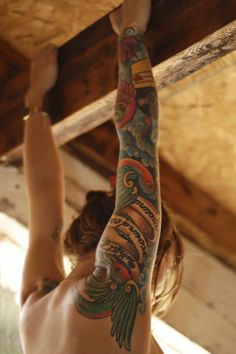 Wow!! Coloured version of earlier pin. Really beautiful and feminine sleeve tattoo.