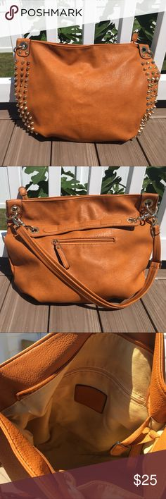 Rust orange hobo style shoulder bag w/ 2 straps Gold studded details on medium/large sized slouchy purse with slight wear and tear. Great for carrying books. Tan lining on inside has minor signs of wear. Inside has 1 zipper and 2 open pockets. One additional zipper pocket in outside. Longer strap is adjustable, shorter strap is 12in and both are removable. Measurements: 20in D x 18in L x 14in H. Bags Hobos