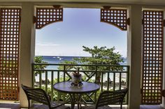 Imagine enjoying a glass of wine and watching the sunset from this balcony? At the Bay Gardens Beach Resort & Spa in Saint Lucia. #stlucia #hotel #beachresort #beachfront #resort #caribbean
