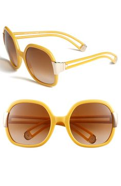 Tory Burch 56mm Oversized Sunglasses-Free shipping and returns on Tory Burch 56mm Oversized Sunglasses at Nordstrom.com. Looped arms add an updated touch to retro-glam sunglasses styled with full-coverage, gradient lenses.