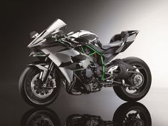 2015 KAWASAKI NINJA H2™R SPECIFICATIONS Engine: Supercharged, in-line four, liquid-cooled Displacement: 998cc Supercharger: Centrifugal, scroll-type Maximum Power: approx 300hp Frame: Trellis, high-tensile steel Tires F: 120/600 R17 (racing slick) R: 190/650 R17 (racing slick)
