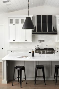 Clean, modern and refreshing white farmhouse kitchen design for you to relish in. Endless perfection with a kitchen that has it all - matte black pendants, a grey kitchen island and oversized black range hood. #KitchenIsland #AllWhiteKitchen #ModernKitchenDesign Kitchen Design Open, Luxury Kitchen Design, Kitchen Cabinet Design, Luxury Kitchens, Kitchen Interior, Grey Kitchen Island, All White Kitchen, White Kitchen Cabinets, Kitchen Inspiration