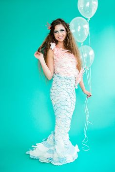 DIY mermaid costume made from coffee filters and medicine cups.