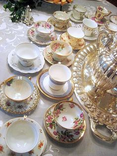 *Elegant tea party with assorted cups and saucers.