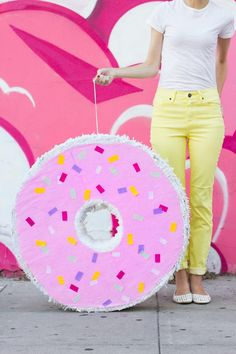 Grab some crêpe paper and cut some fringe. There's nothing like a giant donut piñata filled with candy to put a huge smile on everyone's face at your next shindig! Best part, it's super cheap to make. Forget buying a $40 one from Party City.
