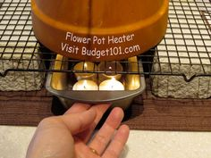 DIY Flower Pot Heater Power go out unexpectedly in your area? Here's a very simple, dirt cheap homemade heater made out of Flower pots and tealights that you can put together in under 5 minutes flat- and here's the kicker, It Actually WORKS. Emergency Preparation, Survival Prepping, Emergency Preparedness, Survival Books, Emergency Power, Emergency Supplies, Survival Shelter, Power Outage Preparedness, Emergency Kits