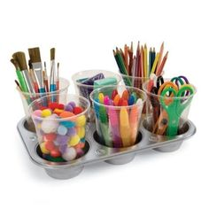 Combine a muffin tin with plastic cups to make a wonderfully mobile storage center for art supplies. | 26 Useful Dollar-Store Finds Every Parent Should Know About