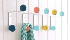 Painted knobs turn simple hardware into a decorative place to store coats and accessories.