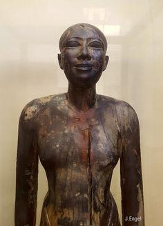 Ebony statue of a man from the erea of King Nefer-Ka-Re.  VIDyn. Saqqara   Egyptian Museum Caïro