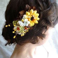 hayloft - a rustic sunflower comb $35 (colors don't go with my wedding, but I love the shape and the hairstyle)