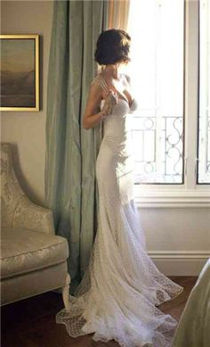 Mermaid wedding gown with a dotted soft tulle. I love the modern vintage look!