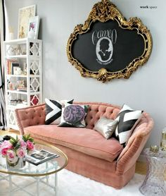 Furniture (pink couch, glass table, white shelving)