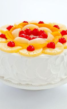 Fruit Cocktail Cake: Inspired by the Del Monte classic, we processed canned pineapple, peaches, pears, and maraschino cherries into yellow cake batter and garnished the resulting tube cake with a blanket of lightly sweetened whipped cream and a crown of mixed fruit. The cake makes the perfect showpiece for a summer buffet. Fruit Cocktail Cake, Maraschino Cherries, American Cake, Sweetened Whipped Cream, Canned Pineapple, Tea Time Snacks, Yellow Cake Mixes, Mixed Fruit, Pie Cake