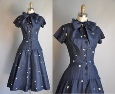 50's dress... I NEED this! I love the top and buttons. And the bow ahh!!!!!