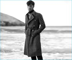 Axel Hermann wears double-breasted tartan trench Gucci, double-collar shirt By Walid, turtleneck cashmere sweater Alexander McQueen, and flared trousers Burberry.
