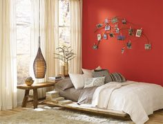 A very 'zen' organic bedroom accented with a pop of Cayenne, one of Pantone's hot colors for spring.  Looking to warm up your room?  Let our color experts help you find just the right red!