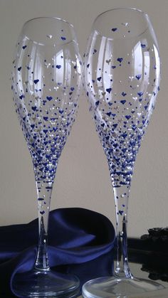 Beautiful set of 2 wine glasses with delicate hand painted hearts and dots in blue and pearl color. Hand wash only. The glasses can be