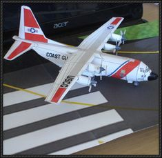 This airplane paper model is an USCG version Lockheed Hercules, a four-engine turboprop military transport aircraft designed and built originally by Paper Airplane Models, Model Airplanes, Paper Models, Paper Planes, C 130, Origami, Wooden Airplane, Paper Magic, Aircraft Design