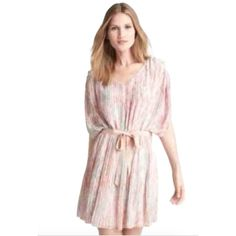 "Jessica Simpson Sz 14 Pleated Chiffon Pink Dress Jessica Simpson Sz 14 Pleated Chiffon Pink Apricot Wash Knee Length Lined Stretch Waist Band Dress with Belt NWT. ✨✨ Multi-Color Polyester Dolman/Cap Sleeve Faux Buttons on Sleeves Chest/Bust: 40 + inches Length 38"" New with tags! Jessica Simpson Dresses"