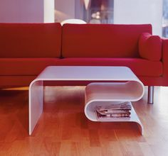 We love this thermoformed table by Ole Petter Wullum using Corian® Designer White.