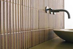 "ANN SACKS Clodagh Core 4"" x 6"" ripple ceramic field in corten with @Kallista Plumbing One wall mount lavatory basin set, ANN SACKS Spool vessels lavatory, and console table top (photographer: Tom McWilliam)"