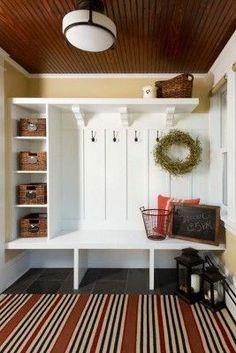 Open sections below, small shelves on side, open shelf above, bench, many hooks