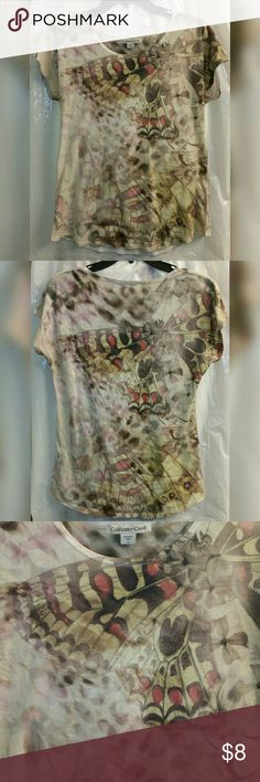 Coldwater Creek Butterfly in Watercolor Tee This pretty little shirt has a gorgeous replica of a butterfly fused into a painted Mosaic background on this fashionable tee shirt. Grab this one and amaze your friends as you become a living art piece. Coldwater Creek Tops Tees - Short Sleeve