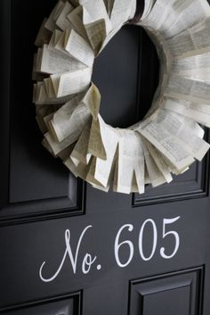love door with house # cool wreath also. I may paint our address on our door.