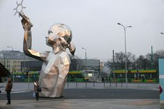 David Mesguich (previously) is a street artist who focuses on placing large-scale geometric sculptures in public spaces around Belgium, France and Poland. Recently, his work has focused on the difficult journey of refugees in Europe. His series STATELESS includes two carved portraits of refugees mad