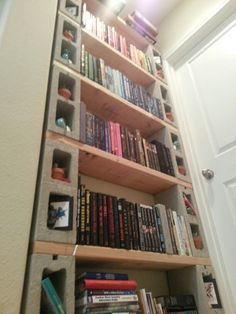 DIY cinder block bookshelf! It only costs 40$ bucks to make. Totally cute!