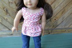 Pretty pink floral peplum top by camelotstreasures on Etsy. Made using the Liberty Jane Clothing Peplum Top pattern. Get it here http://www.pixiefaire.com/products/peplum-top-18-doll-clothes. #pixiefaire #libertyjane #peplumtop
