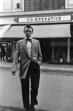 29th May 1954 A young fashionable Teddy Boy pictured outside the Co-op in Tottenham, North London.