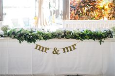 mr & mr wedding sign at paradise cove reception sweetheart table