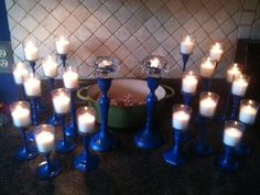 project candle sticks painted blue with votive holders attached to withstand wind