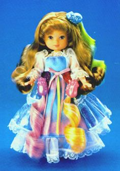 Lady Lovelylocks (this is Maiden Fairhair though) - forget Barbies, this was the only doll toy I ever actually played with. I was the most glamorous person I knew with those colored curls hanging from my animal barrettes.