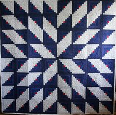 Log Cabin quilt in Starburst set. blue and white