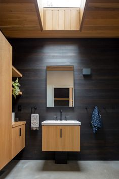 Strand Design have recently completed a new modern lake house in northern Minnesota, for a young couple that enjoy an active outdoor lifestyle. Modern Lake House, Modern House Design, Modern Bathroom, Small Bathroom, Vanity Bathroom, Bathroom Ideas, Bathroom Shelves, Wood Vanity, Wood Bathroom