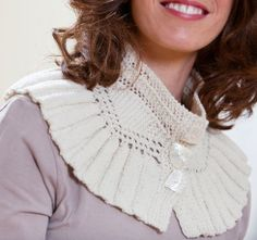 Ashland is a flounce collar in Cody from Mountain Meadow Wool.  Undyed yarn, Mother of Pearl buttons in Shell shape.  Modeled by the beautiful Ayelette Robinson.   Photos by Nancy Rothstein.  http://www.jillwolcottknits.com/shop/ashland/