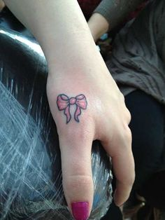 Little bow tattoo design Cute And Small Tattoo Designs For Women