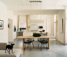 Clean white walls, concrete floors and black Bertoia chairs. Yes, please.