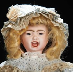 wearing cotton bebe dress and bonnet,undergarments,leather shoes and socks. Condition: generally excellent. Marks: 7 Comments: SFBJ,circa 1900,from the models of the Jumeau art character series. Value Points: rare doll with fine detail of sculpting,beautiful bisque,original body.