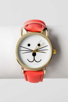 """Be reminded of your furry feline friend every time you check the time! A genuine leather coral band compliments this cat-faced watch with a gold finish. <br><br> - 9"""" band length<br> - .75"""" band width<br> - 1.25"""" diameter (face)<br> - Battery operated<br> - Twist crown to set<br> - Imported <br>"""