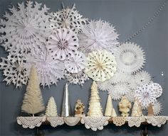 What previously was a large photo above the top shelf is now a wintery snowflake display.  And our typical shelf displays now host some of my handmade holiday trees.  I was a little bit nervous abo...
