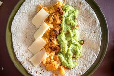 Put some Avocado Salsa Verde in your burritos and everything beyond that is a bonus! I added chicken, Mexican rice, and cheese to this batch -- yum! Chipotle, Avocado Salsa Verde Recipe, Food Dishes, Main Dishes, Tinga Recipe, Cilantro, Carnitas Recipe, Chicken Burritos, Fresh Salsa