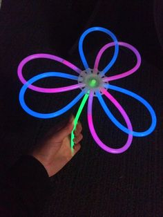 Flowers made from glow stick bracelets and ball connectors. Glow Products, Boat Parade, Glow Sticks, Fairy, Camping, Bracelets, Flowers, Campsite, Bracelet