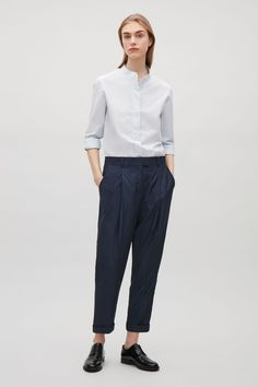 Essentially the Essential ... COS image 7 of Relaxed pleated trousers in Indigo